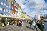 Tourists in Nyhavn  17th Century Waterfront  Copenhagen  Denmark