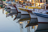 Fishing Boats Reflect in Morning Light in Harbor in Fisherman's Wharf in San Francisco  California