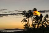 Tiki Torches at Sunset on Poipu Beach Kauai  Hawaii