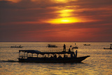 Sunset over Boats on Tonle Sap Lake at Chong Kneas Floating Village  Near Siem Reap  Cambodia