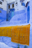 Africa  Morocco  Chefchaouen Rugs Draped on a Wall in the Blue Town