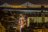 Looking Down onto Broadway and Bay Bridge from Russian Hill at Night in San Francisco  California