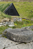 Iceland  West Fjords  Osvor Restored Fisherman's Station  Vintage Stone Wheel in Front  Fishing Hut