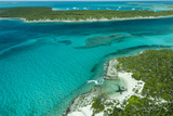 Looking Down at Airplane's Shadow  Jet Ski  Clear Tropical Water and Islands  Exuma Chain  Bahamas