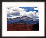 The Sun Breaks Through the Clouds to Highlight the Summit of Pikes Peak Reproduction encadrée