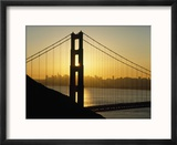 Yellow Sunrise Behind the Golden Gate Bridge with Skyline Behind