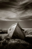 Lonely Old Wooden Fishing Boat on the Saltmarshes at Burnham Deepdale in Norfolk  UK