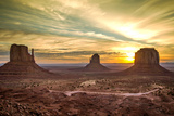 Dawn over East and West Mitten Monuments in Monument Valley  Arizona