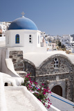 A Classic Blue Dome of a Greek Orthodox Church in the Picturesque Town of Oia  Santorini