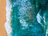 An Aerial View of Waves Crashing Against the Baja Coastline
