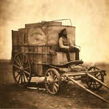 Marcus Sparling  Lull-Length Portrait  Seated on Roger Fenton's Photographic Wagon  1855