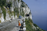Near Trieste  Italy Motorists Pass People on a Scenic Road Atop a Cliff Overlooking a Bay