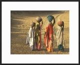 Girls Wearing Sari with Water Jars Walking in the Desert  Pushkar  Rajasthan  India