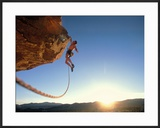 Rock Climber Dangling Off of Cliff