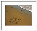 "Heart and ""Love You"" Carved Into Beach Sand with Tid"