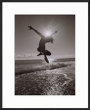 Silhouette of Dancer Jumping Over Atlantic Ocean