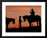 Cowboy and Cowgirl Silhouetted on a Ridge in the Big Horn Mountains  Wyoming  USA