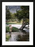 Boy Fishing at Firehole River  Wyoming  USA