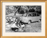People Enjoying a Picnic Beside a 1956 Fiat 600 Multipla  (C1956)