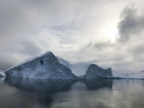 Clouds Above Icebergs In Antarctica's Lemaire Channel