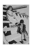 "Two Young Girls Sitting On Steps At San Ildefonso Pueblo New Mexico 1942"" 1942"