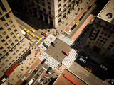 Bird's Eye View of Manhattan  Looking down at People and Yellow Taxi Cabs Going down 5Th Avenue To