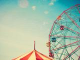 Vintage Colorful Ferris Wheel over Blue Sky