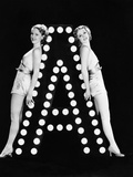 Two Young Women Posing with the Letter A
