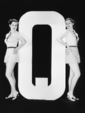 Women Posing with Huge Letter Q