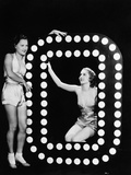Two Young Women Posing with the Letter O