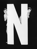 Two Women Hiding behind Huge Letter N