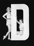 Women Posing with Huge Letter D