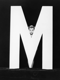 Womans Face with Huge Letter M