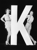 Women Posing with Huge Letter K