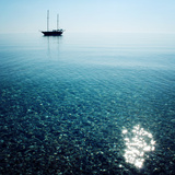 Morning Sea with Boat on the Horizon Aged Photo Sailing Ship Profile Toned Image Sunbeams on Th