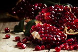 Break Azerbaijan Pomegranate on an Old Table in a Rustic Style  Vintage Wooden Background  Selectiv