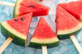 Watermelon Popsicle Raw Food Yummy Fresh Summer Fruit Sweet Dessert on Vintage Old Wood Teak Blue