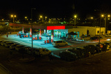 View of a Urban Gas Station Working in the Evening