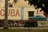 Side Profile of a Vintage Car on an Empty Street  Havana  Cuba