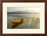 An Adirondack Guide Boat in a Calm Lake with Whiteface Mountain in the Background