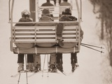 Skiers Riding Chair Lift