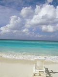 Lone Lounge Chair on Sandy Beach