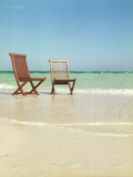 Pair of Wooden Lounge Chairs on Beach