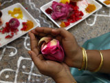A Hindu Woman Worshipper Holding Rose Offering at the Sri Srinivasa Permual Temple  Singapore