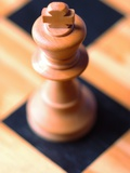 King chess piece on chessboard