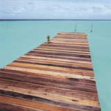 Wooden jetty leading out to sea