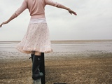 Woman Balancing on a Breakwater