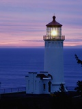 Lit-Up Lighthouse at Twilight