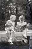 Two Little Girls Sitting on a Bench