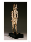 An Egyptian Wood Figure of a Jackal-Headed Deity  New Kingdom  1550-1070 BC